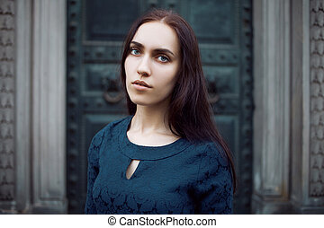 Beautiful young brunette in the city, portrait