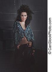 beautiful young brunette model wearing jeans, studio shot