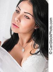 Beautiful young brunette posing in studio.