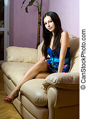 brunette sitting on the sofa