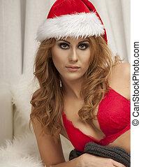 Beautiful young brunette woman as santa girl -christmas portrait