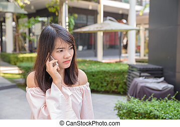 Beautiful young brunette woman calling by phone in the shop