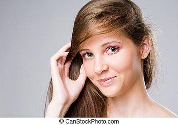Beautiful young brunette woman.