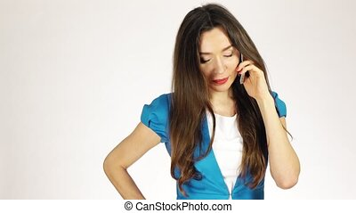 Beautiful young brunette woman talking on her mobile phone against white background. 4K clip