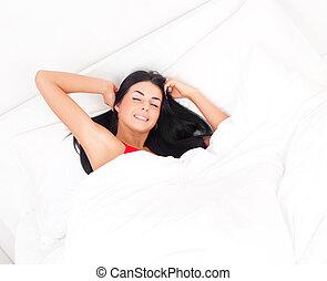 woman waking up - beautiful young brunette woman waking up ...