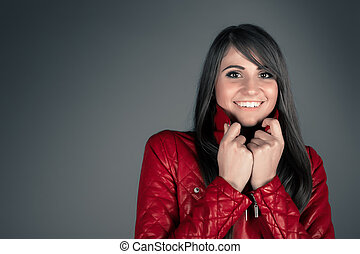 beautiful young brunette woman wearing red leather jacket