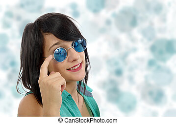beautiful young  brunette woman with blue sunglasses