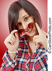 beautiful young  brunette woman with red sunglasses