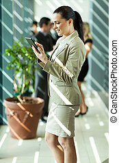 young business executive using tablet computer