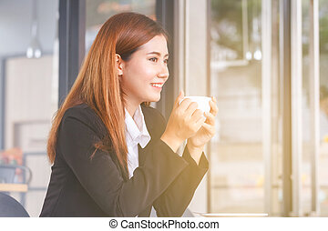 beautiful young business woman drinking coffee