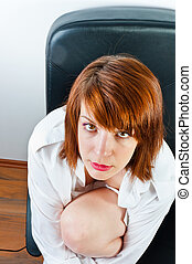 Beautiful young business woman in chair