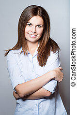 beautiful young Business woman smiling on white background. crossed hands. looks in the camera