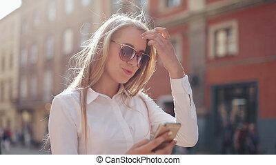 Beautiful young business woman wearing white shirt and using...