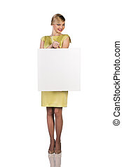 Beautiful young business woman with blank board