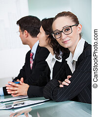 Beautiful young businesswoman in a meeting