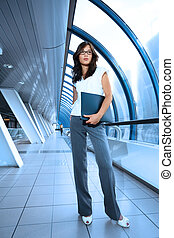 Beautiful young businesswoman in futuristic interior