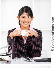 businesswoman in office with coffee