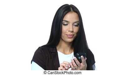 Beautiful young businesswoman is using mobile phone