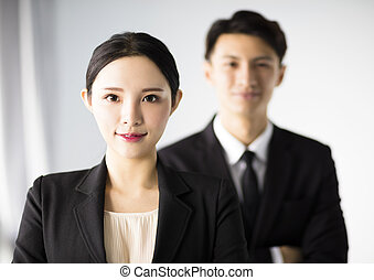 Beautiful young businesswoman with colleagues