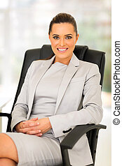 young career woman sitting in office