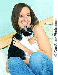 Beautiful Young Caucasian Female With Cute Cat