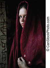 Beautiful young caucasian girl in a cape