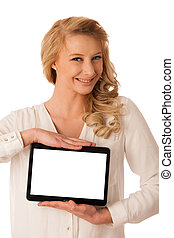 Beautiful young caucasian woman holding a tablet in her hand isolaetd over white background