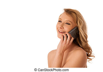 Beautiful young caucasian woman speaking on a smartphone