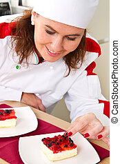 beautiful young chef decorating delicious dessert