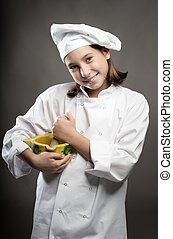 young chef  holding a mortar