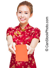 beautiful young chinese woman giving red bag