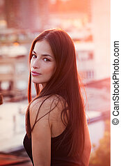 beautiful young city woman portrait at sunset summer close