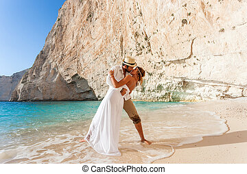 beautiful young couple at the beach - portrait of a...
