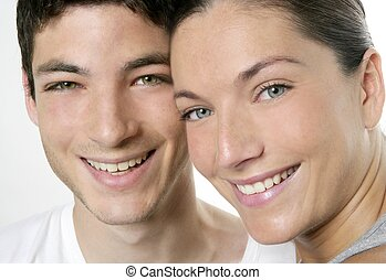 Beautiful young couple closeup portrait over white
