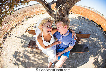 Beautiful young couple having fun outside on a summer day