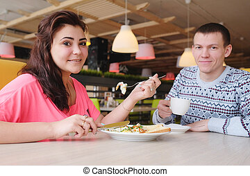Beautiful young couple having lunch