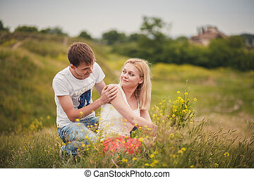 beautiful young couple in a field