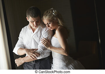 Beautiful young couple kissing with emotional embrace.