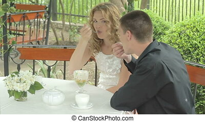Beautiful young couple on date, eat