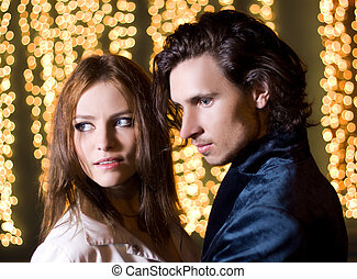Beautiful young couple portrait in night city