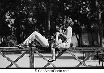 beautiful young couple resting on a fence