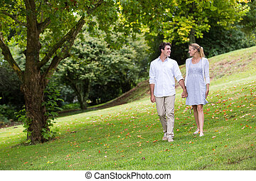 young couple walking at the park