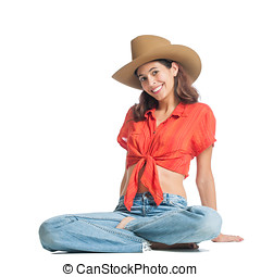 Beautiful young cowgirl isolated on white.