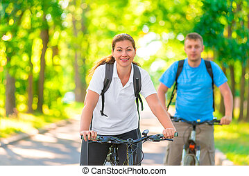 beautiful young cyclists in the park