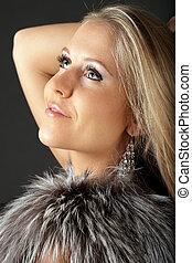 Beautiful Young dreamy woman in fur