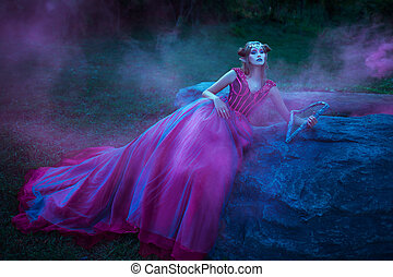 Beautiful young elf woman dressed in long purple dress...