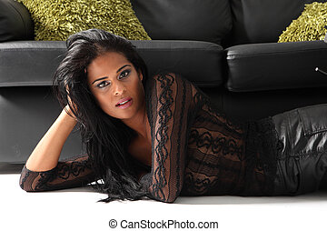 Beautiful young ethnic woman in black lace top
