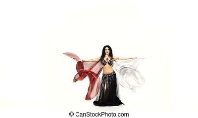 Beautiful young exotic belly dancer with two wings and shaking her hips, on white
