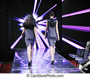 fashion show - beautiful young fashion model woman walking...