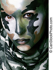 Beautiful young fashion woman with military style clothing ...